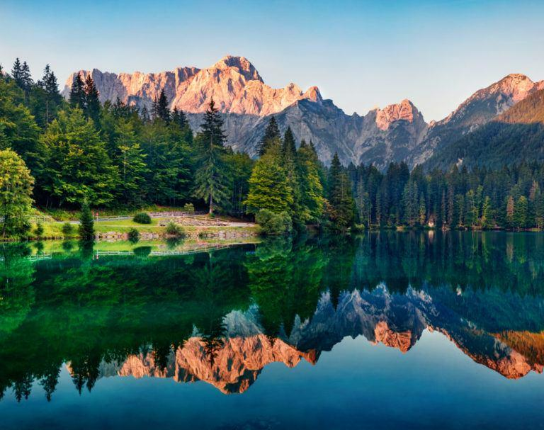 Mountains and trees reflected in lake